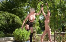 BDSM lesbians in outdoor play